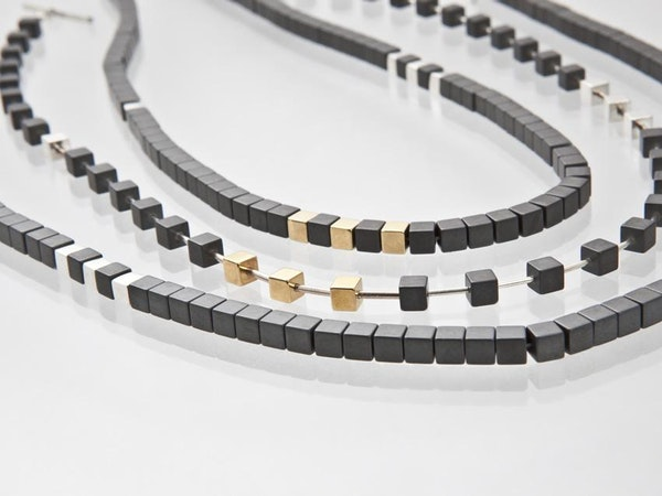 haematite cube necklace with silver and gold vermeil