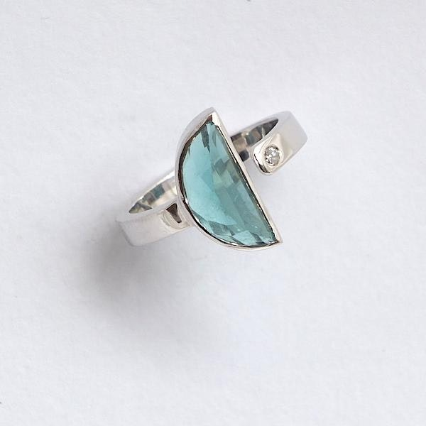 blue tourmaline open silver ring with diamond