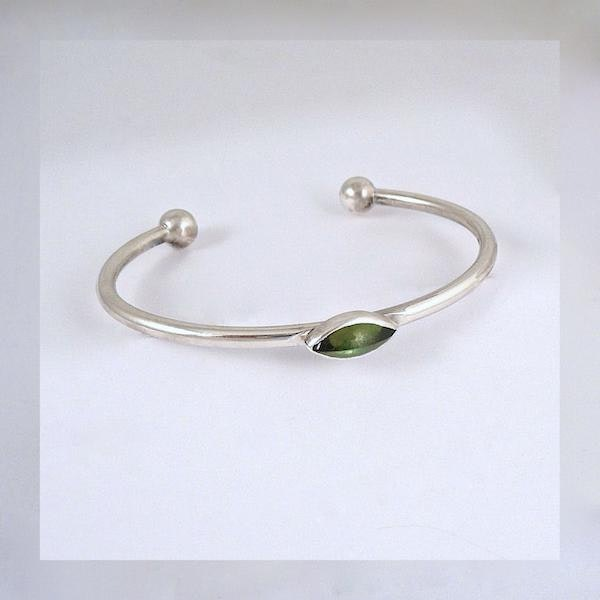 silver bangle with green tourmaline